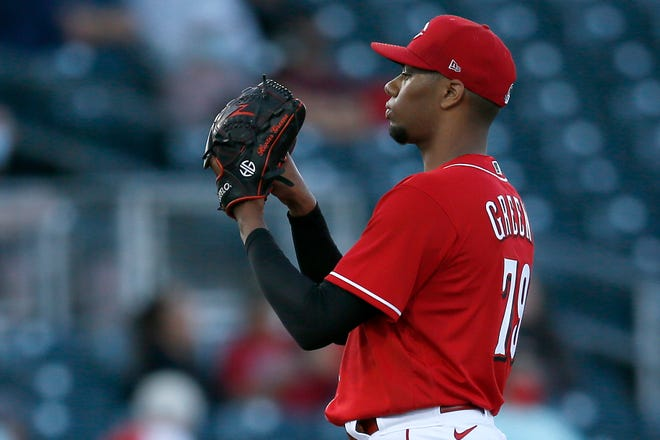 Cincinnati Reds starting pitcher Hunter Greene (79) waits for a signal in the first inning of the MLB Cactus League Spring Training game between the Cincinnati Reds and the Los Angeles Angels at Goodyear Ballpark in Goodyear, Ariz., on Tuesday, March 2, 2021.