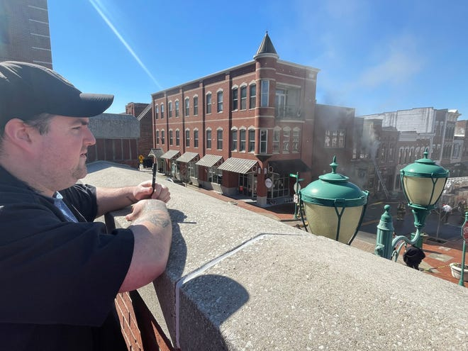 Blackhorse Pub & Brewery manager Andrew Ochoa watches as his place of employment burns after a kitchen fire got out of control on Wednesday, March 3, 2021.