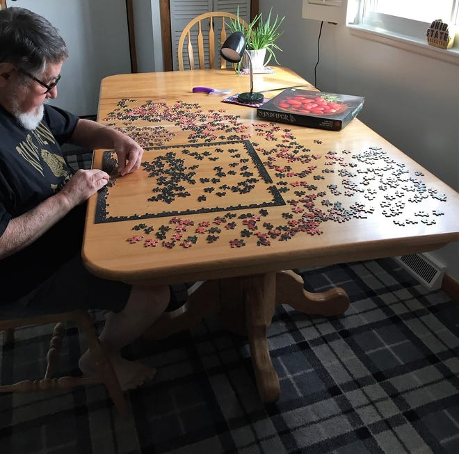 Bob Watson of Coshocton works on a puzzle. He's put together more than 80 puzzles since last spring. Like many, he's found puzzles a way to relax and fill hours during the COVID-19 pandemic.