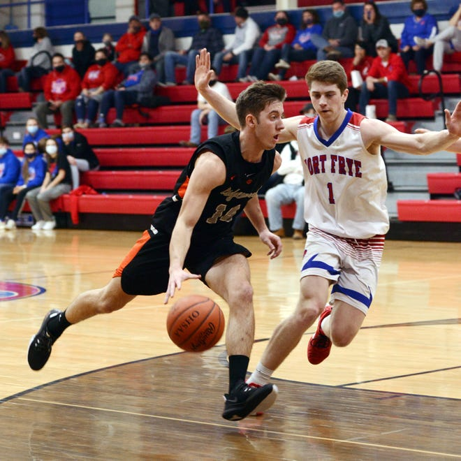 Ridgewood's Dalton Patterson drives into the lane against Fort Frye's Nic Hart in a Division III district semifinal loss on March 2. Patterson was named to the District 5 first team in Division III.
