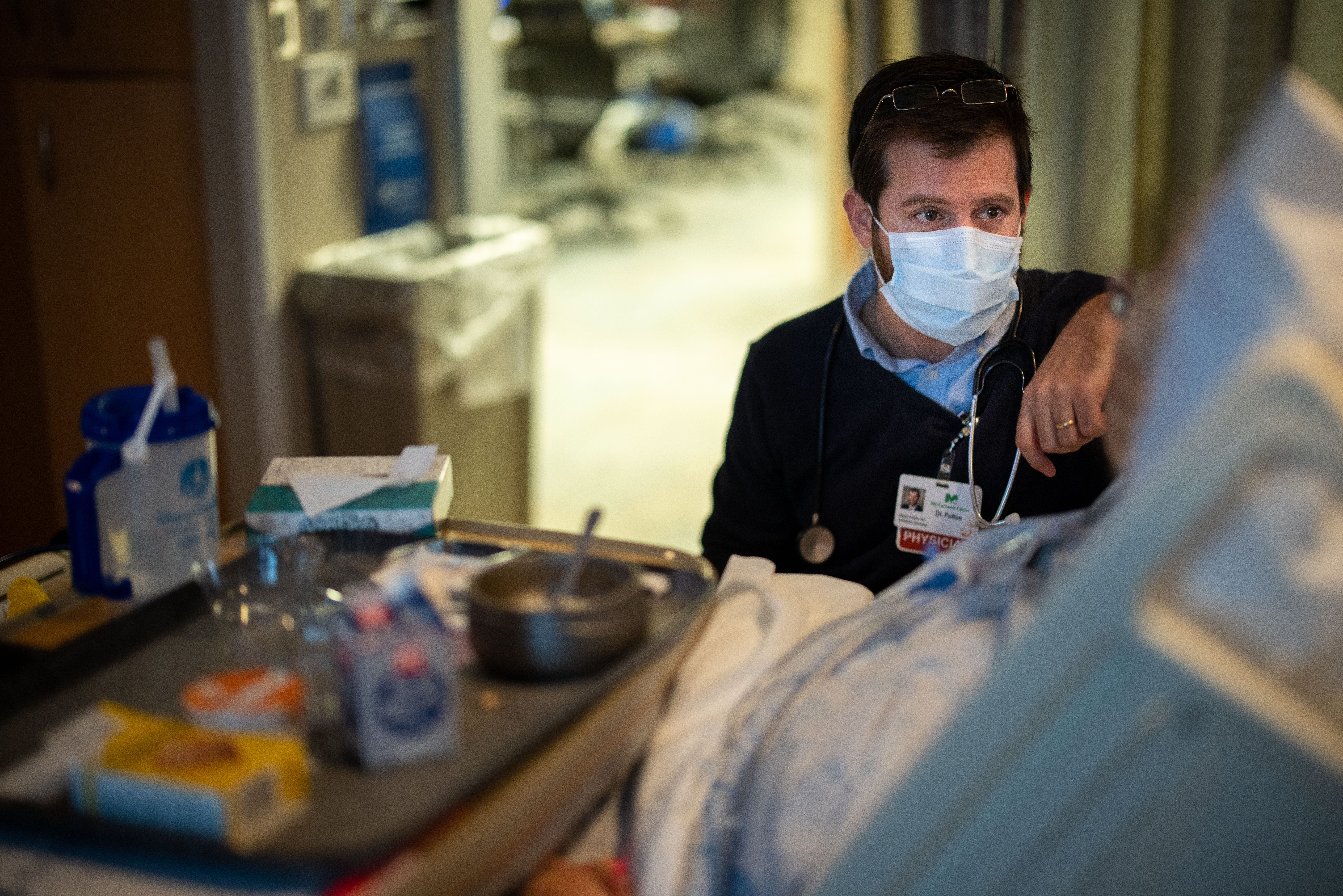 Infectious disease specialist Dr. Dan Fulton talks with a patient in the ICU at Mary Greeley Medical Center in Ames on Dec. 16.