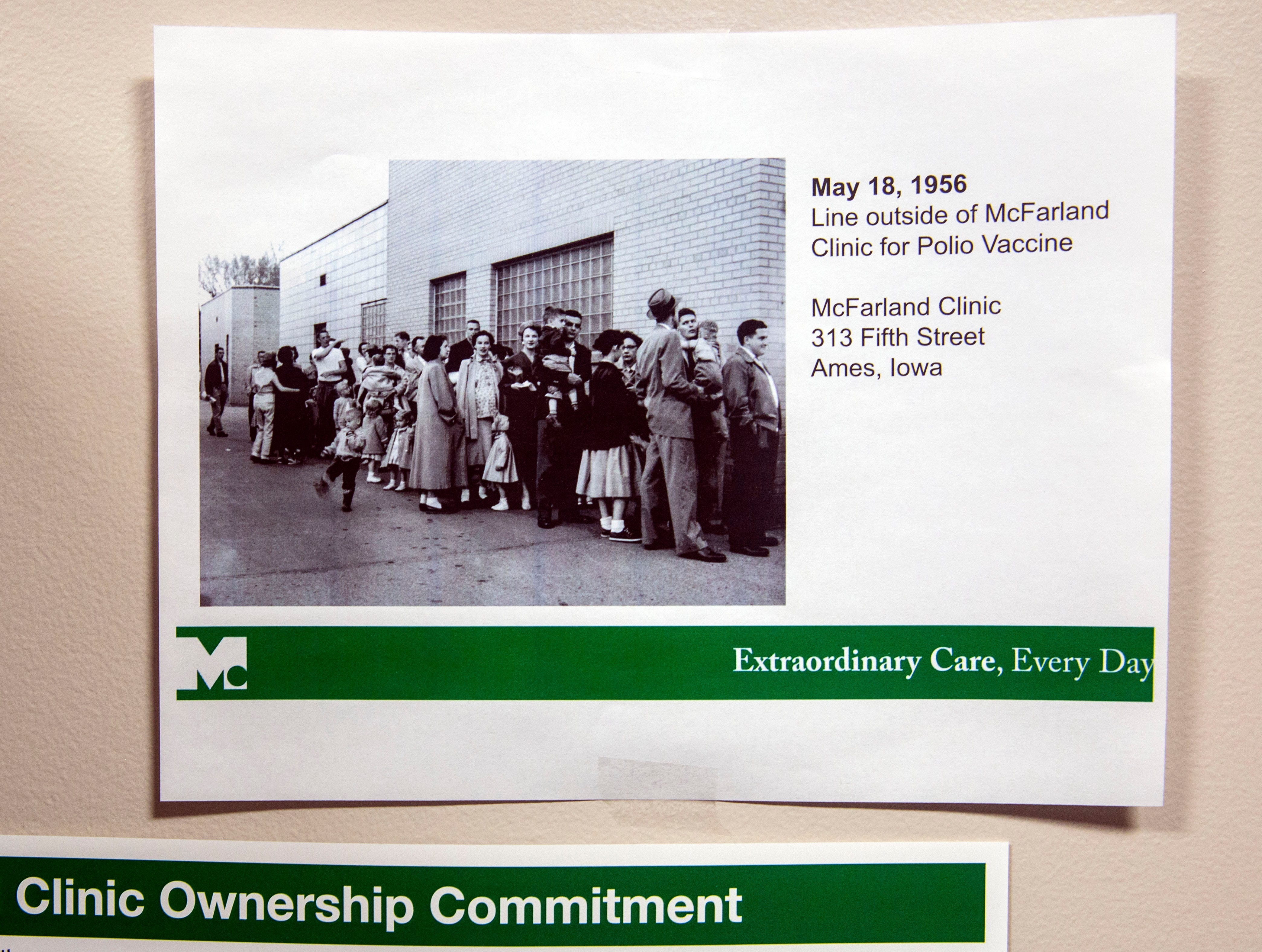 A photo of the line for the polio vaccine at McFarland Clinic in Ames in 1956 hangs on Dr. Dan Fulton's office wall at Mary Greeley Medical Center in Ames.