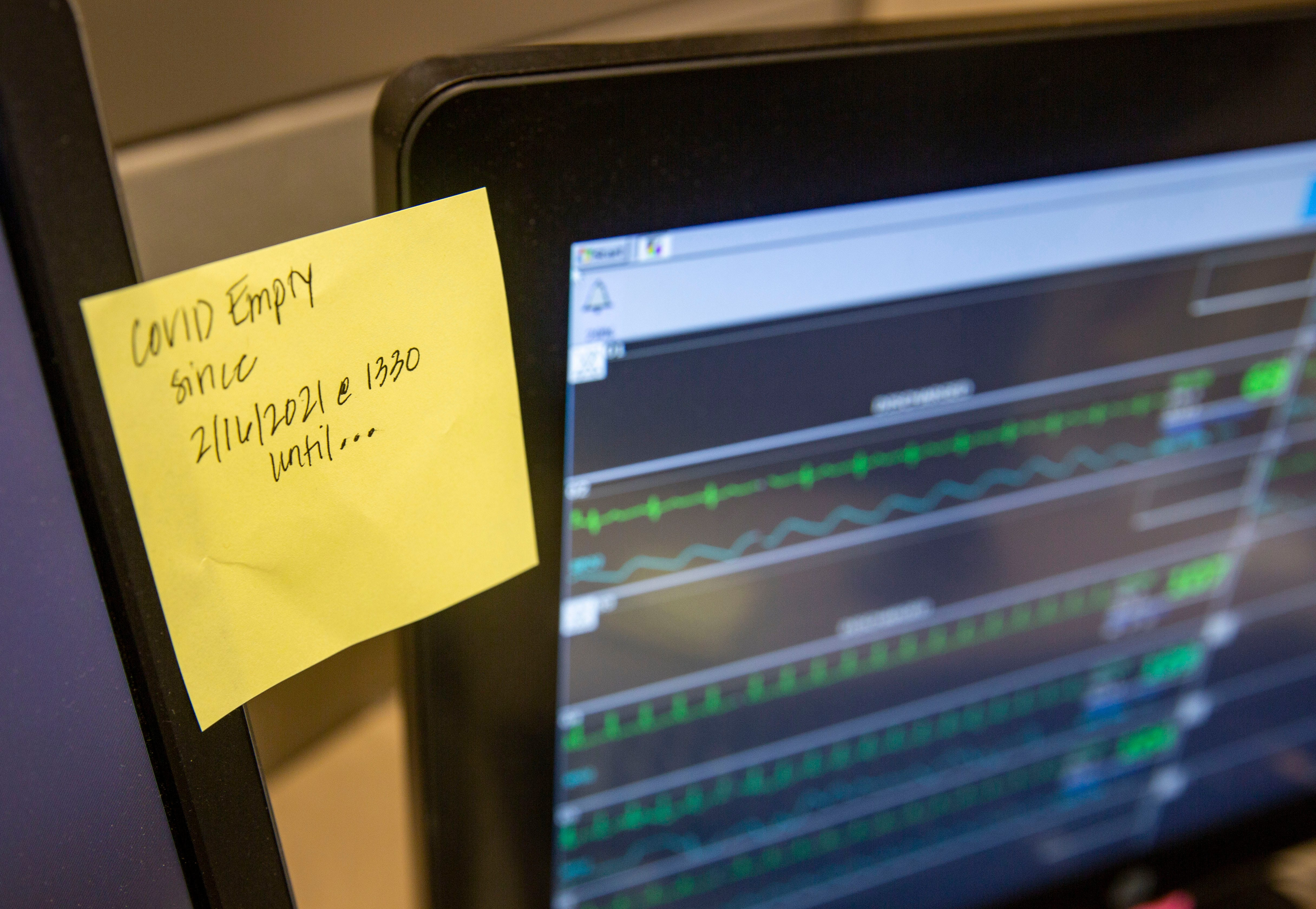 A post-it note lists the last time a COVID patient was in the ICU at Mary Greeley Medical Center in Ames, photographed on Feb. 25, 2021.