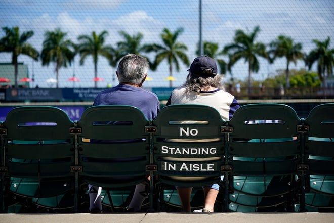 Fans watch a spring training exhibition game between the Pittsburgh Pirates and the Detroit Tigers at LECOM Park in Bradenton on March 2. Because of the coronavirus pandemic, a limited number of fans were permitted at the game.