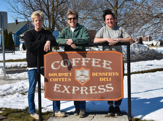 Tina Thompson, center, opened Coffee Express 27 years ago despite doubts which came from several places, including her own mind. The shop eventually became a popular community hub for locals and tourists. On March 1, Thompson and her partner, Rebecca DeTray, on the left, officially transferred the business to new owner Danielle Spence, on the right.