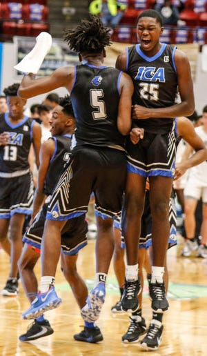 Impact Christian's Ivan Lawson (5) and Issac Edwards celebrate at the buzzer of the FSHAA Class 2A boys basketball state semifinal in Lakeland. Impact faces Orlando Christian Prep on Saturday for the championship.