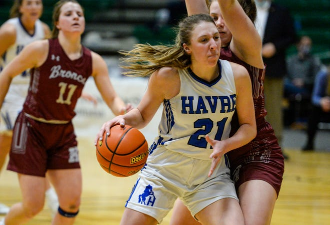 Havre's Yelena Miller works her way to the basket as Hamilton's Katelyn Dickemore during the Class A State Basketball Tournament at the Four Seasons Arena in Great Falls.