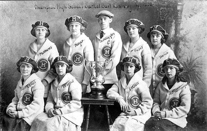 """On March 11, 1921, the Barret Manual Training High School's girls basketball team won the state championship by defeating, 19-8, a Lexington team coached by future governor A.B. """"Happy"""" Chandler. Front row, from left: forward Mittie Eblen, guard Francele """"Skeet"""" Harris, forward Ethel Brown and center Agnes Rothenhoefer. Back row: guard Cynthia Mathews, guard Helen Kiefer, coach William Griffin """"Jew"""" Schoepflin, guard Virginia Posey and guard Anna Hulse. The team went 10-0, part of Schoepflin's career 80-15 record."""