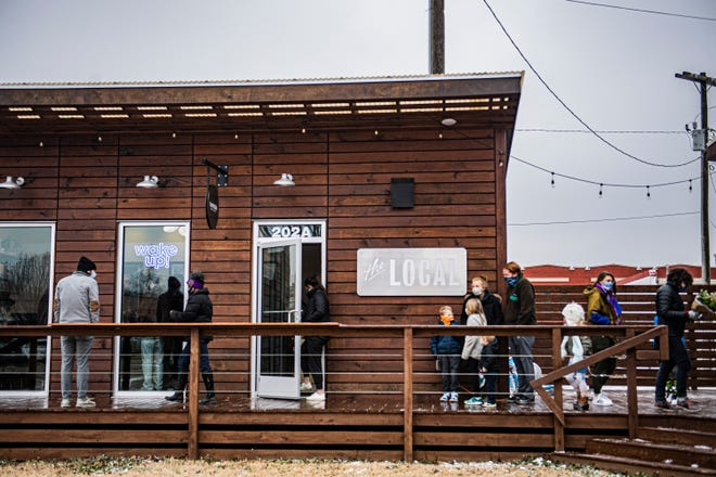 People stand outside the LOCAL waiting to go inside the pop-up event at Turntable Coffee Counter, they serviced at least 200 people the day of their pop-up event, on Saturday, Feb 13, 2021 in Jackson, Tenn.