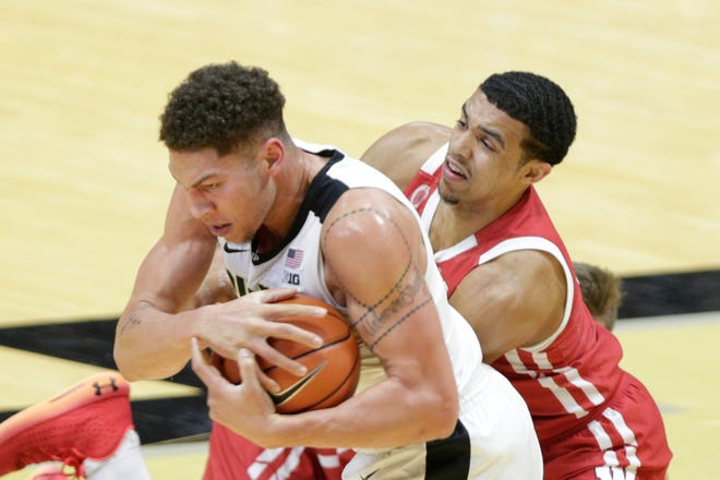 Purdue forward Mason Gillis (0) and Wisconsin guard D'Mitrik Trice (0) go for the ball during the first half of an NCAA men's basketball game, Tuesday, March 2, 2021 at Mackey Arena in West Lafayette.