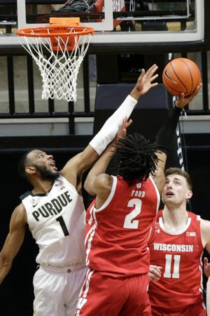 Purdue forward Aaron Wheeler (1) goes up to block Wisconsin forward Aleem Ford (2) during the second half of an NCAA men's basketball game, Tuesday, March 2, 2021 at Mackey Arena in West Lafayette.