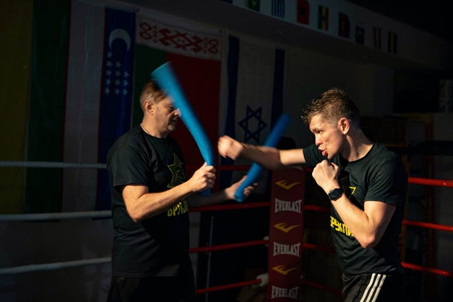 Boxer Yuri Foreman trains with Misha Khaytsis before his Saturday bout with Jimmy Williams in Louisville.
