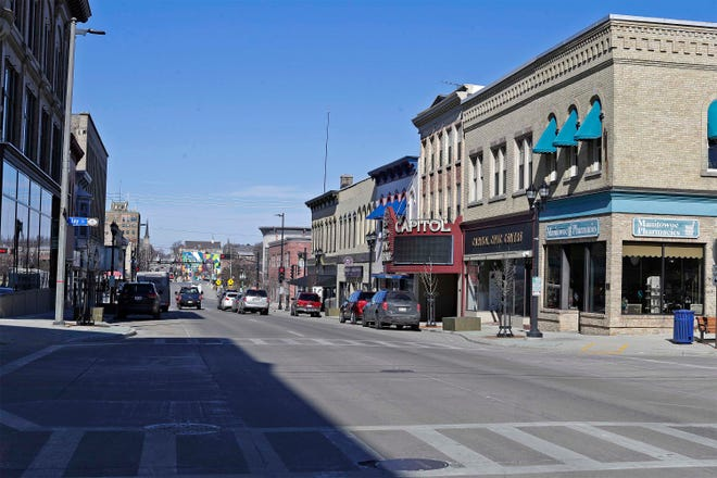 A view of downtown along 8th St. as seen looking north, Tuesday, March 2, 2021, in Manitowoc, Wis.