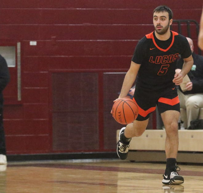 Ethan Sauder became the eighth member of the 1,000-point club at Lucas High School in a 34-26 win over South Central on Tuesday.
