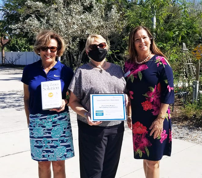 Calusa Garden Club's Sharon Lewis and Sara Wolf with Chante Pemberton of Blue Zones Project.