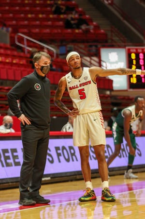 BSU coach James Whitford (left) speaks with senior Ishmael El-Amin (right) during the Cardinals' game against Eastern Michign on March 2, 2021.