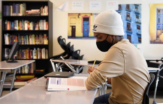 Junior Geoffrey Lawrence works on his assignment in his global perspective class at John Overton High School in Nashville, Tenn., Wednesday, March 3, 2021.