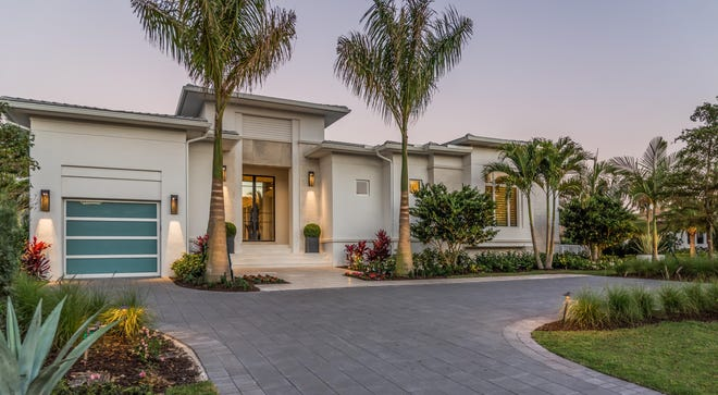 London Bay Homes' stunning new luxury Portmore move-in ready estate is now complete on Crayton Road in Naples.