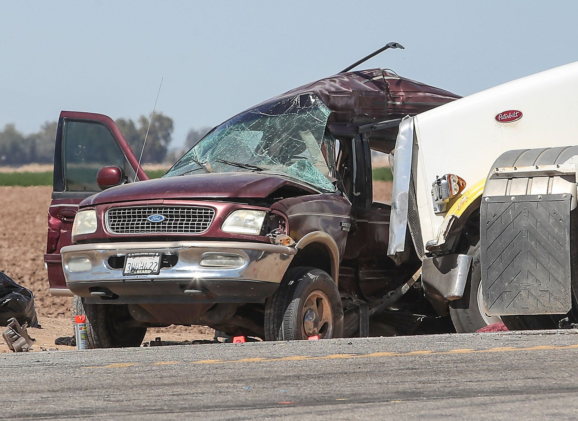 The Ford Expedition that was destroyed when it collided with a big rig sits on the side of State Route 115 near Holtville, Calif., as investigators try to determine what happened March 2.