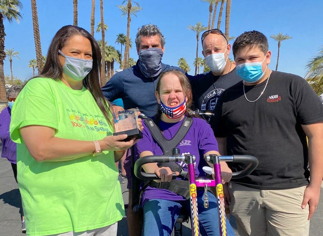 Renova Energy founder and CEO Vince Battaglia (blue shirt, blue mask) poses with Loni, Annmarie, John Paul and Brad Mann at the Tour de Palm Springs on Feb. 27, 2021.