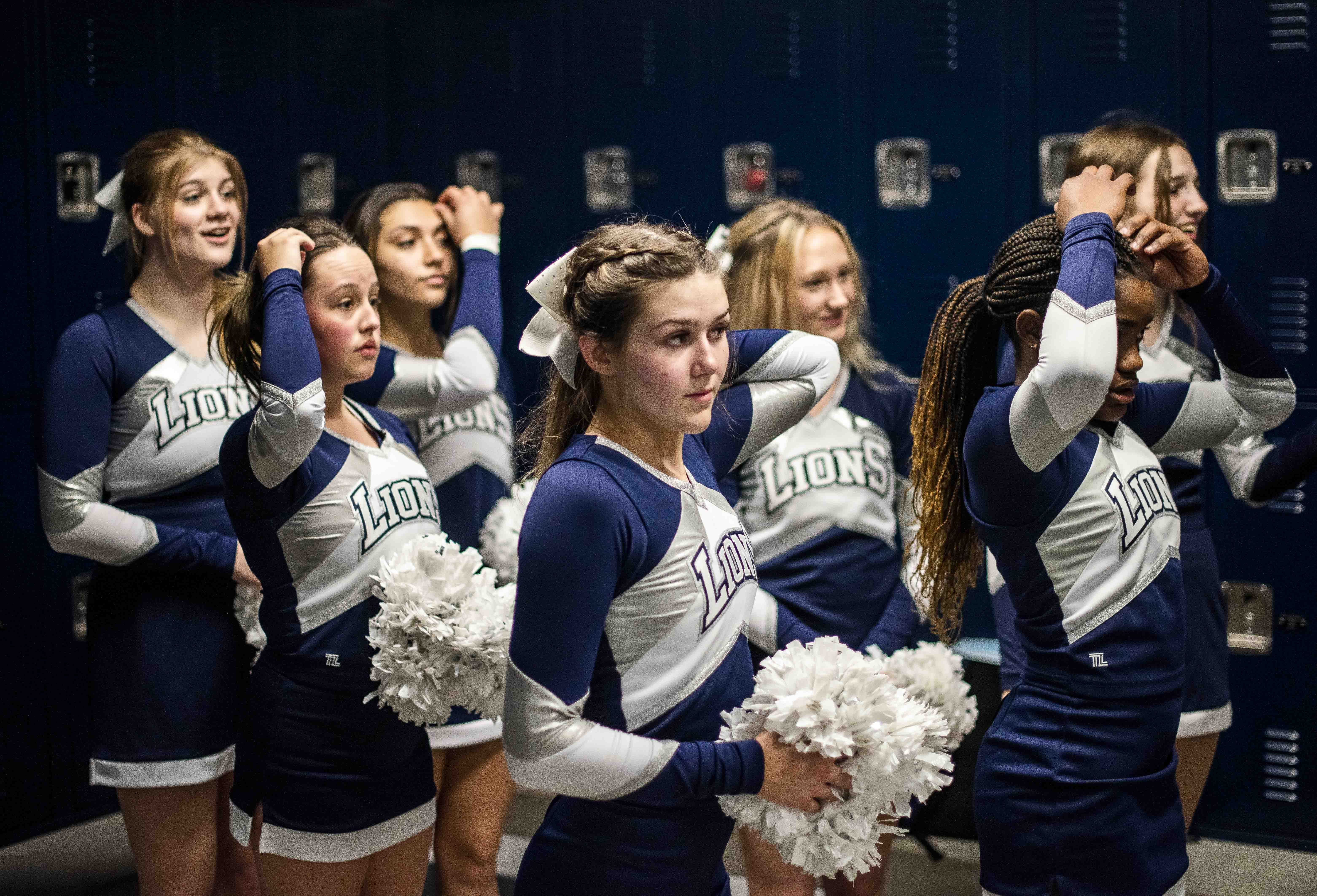 Flipping the switch: NVCA girls basketball players lead boys cheers