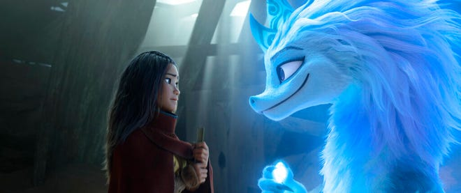 """Raya, voiced by Kelly Marie Tran, left, appears with Sisu the dragon, voiced by Awkwafina, in """"Raya and the Last Dragon."""" The movie opens Friday at Queensgate Movies 13 and Hanover Movies 16 and on Disney+."""