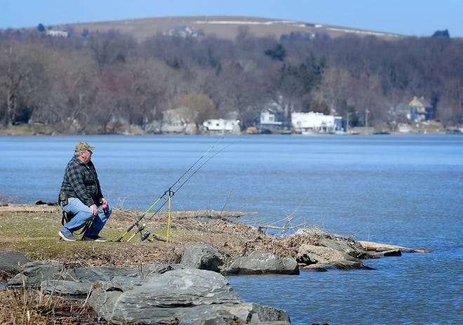 Bryan Miller of Lower Windsor Township fishes from the shore at Long Level along the Susquehanna River Wednesday, March 3, 2021. He says he usually catches pan fish, catfish and smallmouth bass. Over the course of a year, 53 rivers, lakes streams across Pennsylvania were tested for four types of microplastic,including fibers, fragments, film and microbeads. Bill Kalina photo