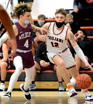 York Suburban's Camden Brewer drives against Mechanicsburg's James Anderson in a District 3 Class 5-A boys' basketball first-round game at York Suburban Tuesday, March 2, 2021. The Trojans went on to win 67-54. Bill Kalina photo