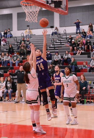San Saba HIgh School's Courtnee Cash (14) goes up for a layup in a Region IV-2A semifinal basketball game Feb. 26, 2021.