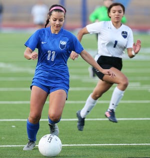 San Angelo Lake View High School's Jazmyne Flores works the ball against Lubbock Estacado in a District 3-4A soccer game at San Angelo Stadium on Tuesday, March 2, 2021.