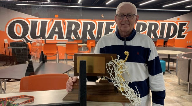 Gary Croon holds the 1976 Class B boys championship trophy in the high school on Wednesday, March 4, 2021.