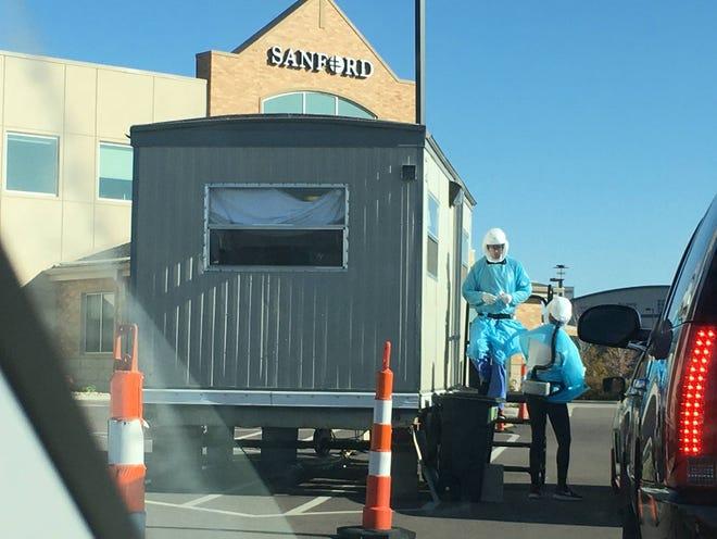 Sanford Health employees do drive-thru testing in October 2020 near the Sanford Sports Complex.
