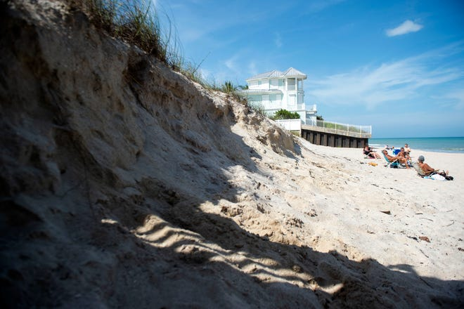 Erosion from hurricanes creates a sharp drop in the dunes at Wabasso Beach Park on Tuesday, March 2, 2021, in Indian River County. A $12 million beach renourishment project is underway to replenish sand along a 3.7 mile stretch.