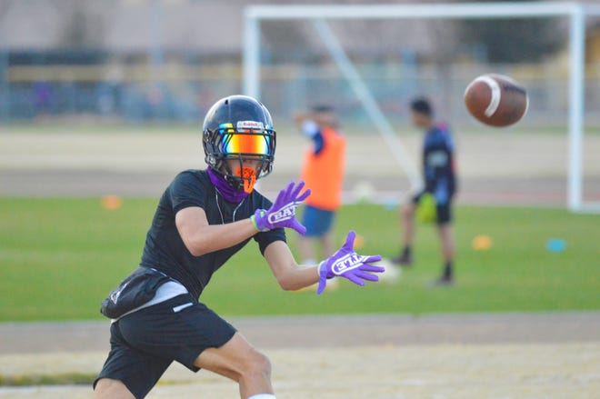 Mission Oak High School receiver Anthony Ledesma catches a pass during practice on March 2, 2021 in Tulare.