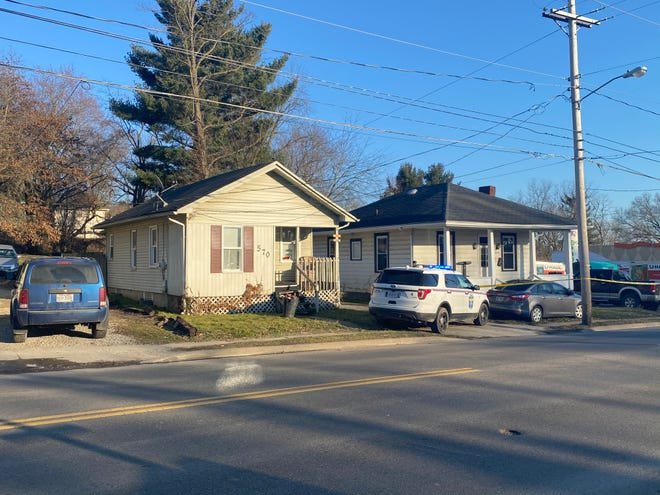 One man has been taken into custody as police serve a search warrant on Pine Street in connection to a shooting on Bates Street Monday.