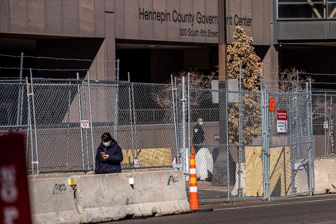 Layers of barbed wire fence and barbed wire were built in front of the Hennepin County government seat in Minneapolis.  Security has been tightened before jury selection begins in the trial of former Minneapolis police officer Derek Chauvin on George Floyd's death.  March 3, 2021