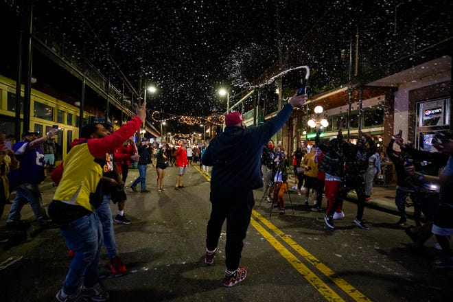 Fans celebrate in the streets of Ybor City in Tampa after the Buccaneers beat the Chiefs in Super Bowl LV.