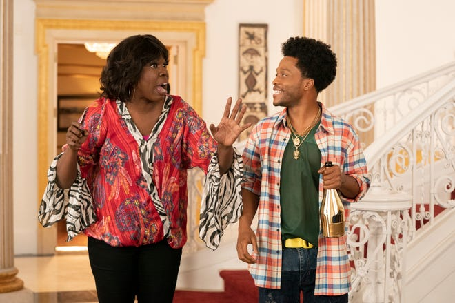 """Mary Junson (Leslie Jones) and son Lavelle (Jermaine Fowler) enjoy the perks of Zamundan royalty in """"Coming 2 America."""""""