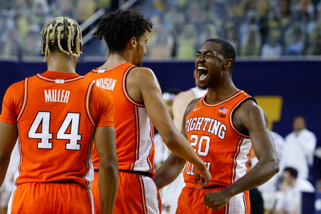 Illinois guards Adam Miller, Jacob Grandison and Da'Monte Williams celebrate during the first half of their win against Michigan at the Crisler Center.