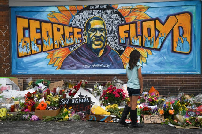A peaceful vigil is held at the George Floyd memorial at the Cup Foods Market in Minneapolis on June, 1, 2020. Floyd died in police custody on May 25 at this location.