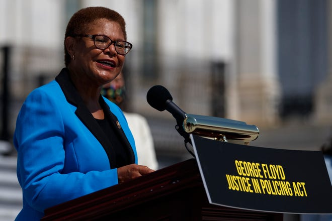 FILE - In this June 25, 2020, file photo Rep. Karen Bass, D-Calif., speaks during a news conference on the House East Front Steps on Capitol Hill in Washington ahead of the House vote on the George Floyd Justice in Policing Act of 2020. California Congresswoman Bass has emerged a leading contender to be Democrats' vice presidential candidate. Allies say her reputation as a bridge-builder would make her a strong partner to presumptive Democratic presidential nominee. (AP Photo/Carolyn Kaster, File) ORG XMIT: WX202