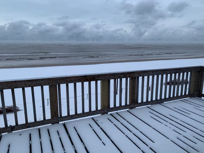 Despite many winters on the coast, columnist Michael Barnes had never seen a Texas beach white with snow before the February winter storm. Virtually nobody else had remained at Surfside Beach on Follett's Island by this dawn.