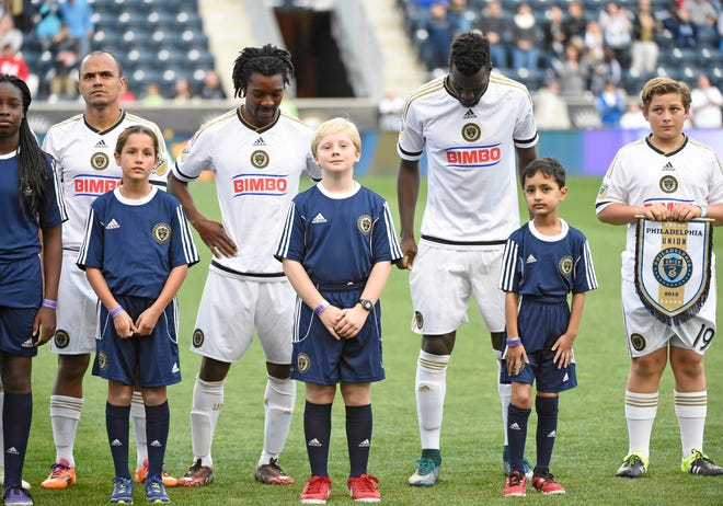 """Philadelphia Union midfielder Michael Lahoud, center, stands with teammates Fabinho, left, and C.J. Sapong as well as youth soccer players during introductions before a 2015 match. """"Soccer is my everything,"""" Lahoud said. """"It gave me validation, meaning, friends, education and a career.Soccer is my life."""""""