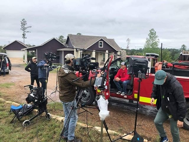 """In October 2018, TV star Mike Rowe filmed a new episode of """"Returning the Favor,"""" a show that chronicles Rowe traveling throughout the country surprising do-gooders with gifts of support, in Bastrop County. Rowe was surprising Blake """"PeeWee"""" Henson, a career and volunteer firefighter who founded the Texas Firewalkers."""