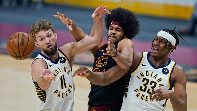 Indiana Pacers' Domantas Sabonis (11) and Myles Turner (33) and Cleveland Cavaliers' Jarrett Allen (31) reach for a rebound in the first half of an NBA basketball game Wednesday, March 3, 2021, in Cleveland. (AP Photo/Tony Dejak)