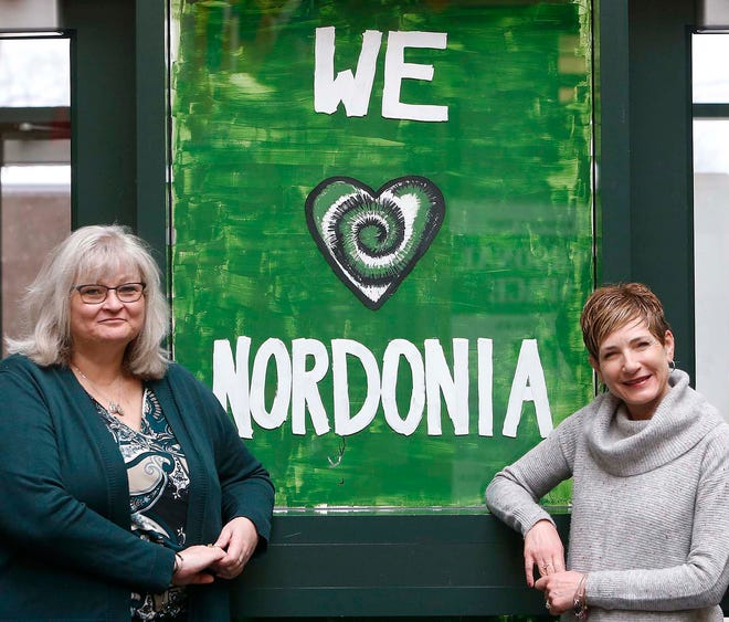 Tammy Strong, left, of the Nordonia Hills Board of Education, and Chrisy Siewert, former PTSA president at Nordonia High School Thursday, March 4, 2021 in Macedonia, Ohio. Strong has been named the Achievement Award winner by the PTSA and she was nominated by Siewert.