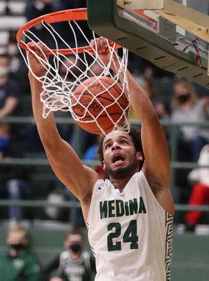 Medina's Corey Tripp has committed to play basketball at Wofford College. [Karen Schiely/Beacon Journal]