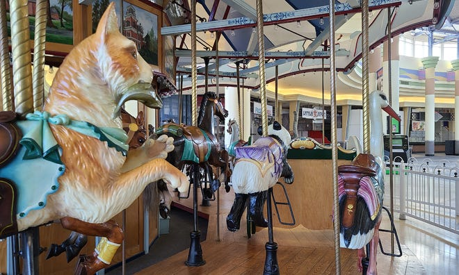 The carousel sits motionless in the mostly empty food court last month at Chapel Hill Mall in Akron.