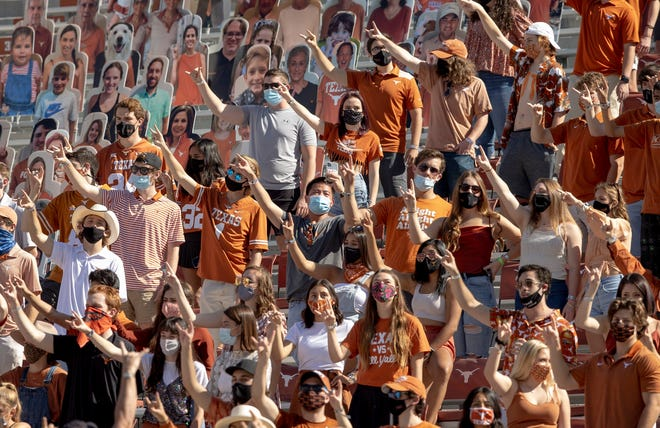"""Texas fans sing """"The Eyes of Texas"""" during the game against West Virginia at Royal-Memorial Stadium on Saturday November 7, 2020. The debate around the song reignited this week when former Longhorn Caden Stern tweeted that he and other teammates have been threatened by donors for their stance against the song."""