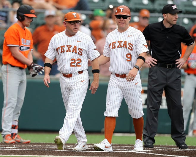 Texas head coach David Pierce, left, and assistant coach Sean Allen both played college baseball at Houston. The Longhorns will travel to Houston for a three-game series this weekend.